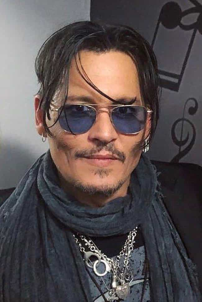 Johnny Depp is listed (or ranked) 2 on the list 20 Famous Single Dads