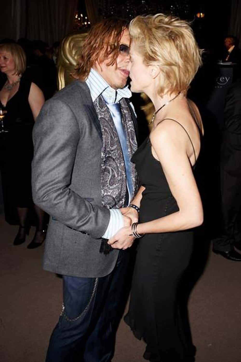 Mickey Rourke is listed (or ranked) 1 on the list Courtney Love's Loves & Hookups