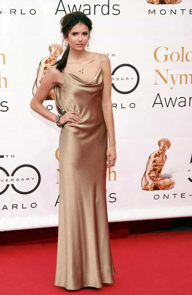 Nina Dobrev is listed (or ranked) 2 on the list The Most Beautiful Celebrity in a Golden Dress