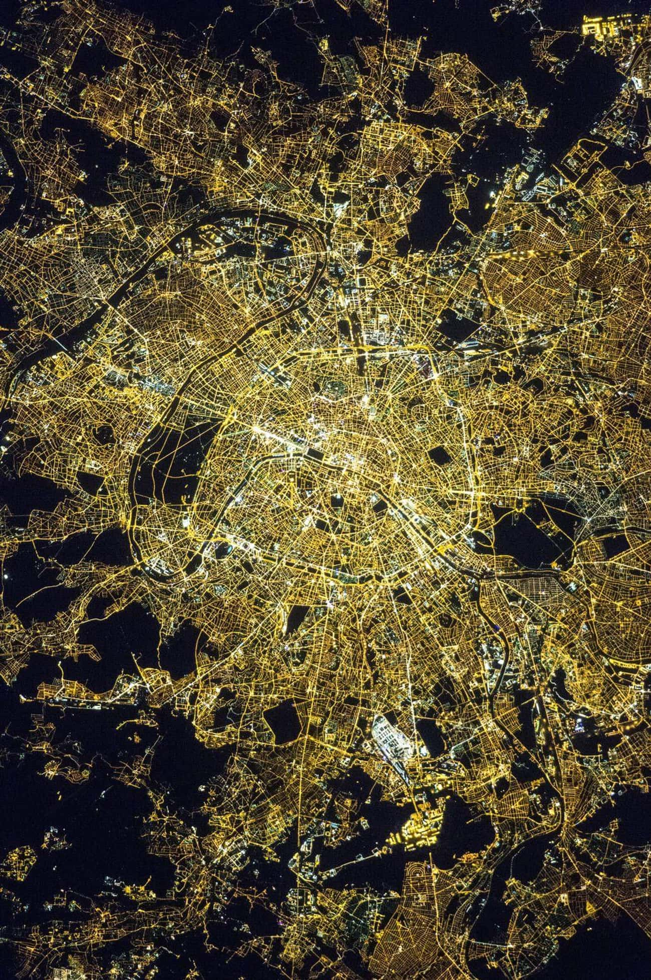 Paris, Living Up to Its Nickna is listed (or ranked) 1 on the list Cool Aerial Photos of Cities at Night
